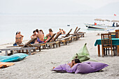 Tourists at beach, Gili Air, Lombok, Indonesia