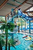 Guests in front of the water slide at the indoor swimming pool, Blaustein, Swabian Alb, Baden-Wuerttemberg, Germany