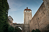 watch tower leading across a stone bridge to the center of Vellberg, Schwaebisch Hall, Baden-Wuerttemberg, Germany