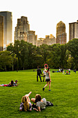 People relaxing on the Sheep Meadow, Central Park, Manhattan, New York, USA