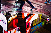 Reflection of a neon sign in a puddle, Times Square, Midtown, Manhattan, New York, USA