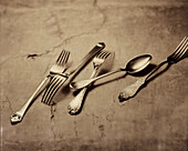 Various old cutlery on a table, Forks and Spoons, Cutlery