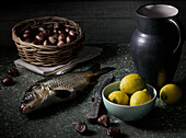 Still life with carp, lemons and chestnut