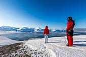 Couple enjoying the view towards Longyearbyen, Spitzbergen, Svalbard, Norway