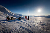 People in the snowy landscape of Spitzbergen with snowmobiles, Spitzbergen, Svalbard, Norway