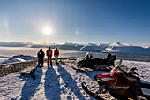 People in snowy Spitzbergen with snowmobiles, Spitzbergen, Svalbard, Norway