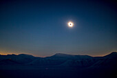Snowy mountains during the total solar eclipse, Spitzbergen, Svalbard, Norway