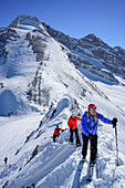 Three persons ascending on a ridge towards Kleiner Kaserer, Olperer and Fussstein in the background, Kleiner Kaserer, valley of Schmirn, Zillertal Alps, Tyrol, Austria