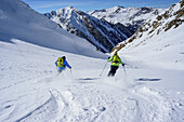 Two persons back-country skiing downhill from Frauenwand, Frauenwand, valley of Schmirn, Zillertal Alps, Tyrol, Austria