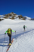 Two persons back-country skiing ascending towards Schneespitze, Schneespitze, valley of Pflersch, Stubai Alps, South Tyrol, Italy