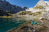 Lake Drachensee with toy dragon, vorderer Drachenkopf, mountains, near Ehrwald, district Reutte, Tyrol, Austria, Europe