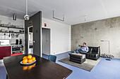 man in a modern prefab apartment in Berlin, Alexanderplatz, Berlin, Germany