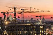 View at sunset from Alexanderplatz towards cranes, Berlin, Germany