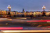 view from the Lombardsbridge over the Binnenalster to Jungfernstieg and town hall at dusk at Christmas, Hamburg, Germany