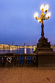 view from the Lombards bridge over the Binnenalster to Jungfernstieg and town hall at dusk at Christmas, Hamburg, Germany