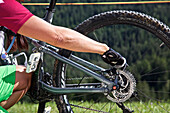 mountain biker adjusting the disc brake on her bike, Mountain bike, MTB, Sport