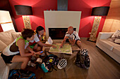 mountain bikers in a hotel looking at a tour-map, Trentino, Italy