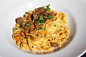 Fettucines with ragout Trentino, Italy