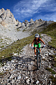 mountain biker on a single-trail at Latemar, Trentino Italy