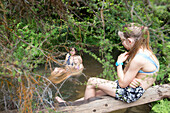 Taking a bath in the thermal river, Kerosene Creek, close to Rotorua, North Island, New Zealand