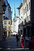 Tourists at the weekend in Skunu Iela, cathedral square in the back, old town centre, Riga, Latvia