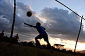 Boys playing football near Champasak near Pakse, south-Laos, Laos, Asia