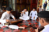 Playing music in the cathedral of Tay Ninh, Vietnam, Asia