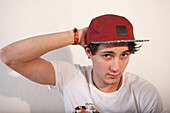 Young man trying on a baseball cap