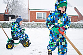 Boys playing in the snow, Cuxhaven, North Sea, Lower Saxony, Germany
