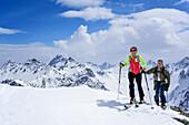 Two persons back-country skiing ascending towards Piz Sursass, Piz Plavna Dadaint in the background, Piz Sursass, Sesvenna Alps, Engadin, Grisons, Switzerland