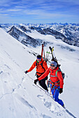 Two persons back-country skiing ascending with ice axe and crampons towards Dreiherrnspitze, Dreiherrnspitze, valley of Ahrntal, Hohe Tauern range, South Tyrol, Italy