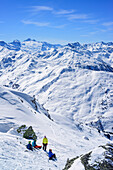 Several persons back-country skiing having a break at summit of Gilfert, view to Tux Alps and Zillertal Alps, Gilfert, Tux Alps, Tyrol, Austria