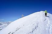 Woman back-country skiing ascending on ridge towards Pizzo Tresero, Pizzo Tresero, Val dei Forni, Ortler range, Lombardy, Italy