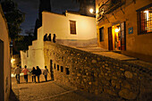 Night in the alleys of the Albaicin, alley down to the center, Granada, Andalusia, Spain
