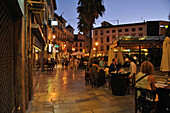 Plaza Romanilla with people and outdoor bars in the evening, Granada, Andalusia, Spain