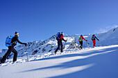 Group of persons back-country skiing ascending towards Pallspitze, Pallspitze, Langer Grund, Kitzbuehel range, Tyrol, Austria