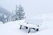 Snow-covered bench, Wallberg, Bavarian Alps, Upper Bavaria, Bavaria, Germany