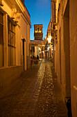 Cobblestone lane in the evening, Calle San Pedro, in the white town of Arcos de la Frontera, Cadiz province, Andalusia, Spain, Europe
