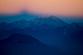 At sunset Triglav casting its shadow in the eastern sky, Julian Alps, Slovenia