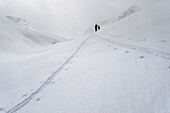 The tracks of two backcountry skiers merging, ascent towards the Col des Roux and the Cabane de Prafleuri, Pennine Alps, canton of Valais, Switzerland