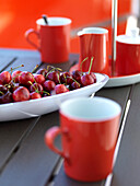 Red cherries on a porcelain plate, red cups, Mallorca, Spain