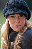 Young woman wearing black knitted cap, Bavaria, Germany