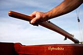 Hand on the tiller of a 40sqm Skerry Cruiser, Lake Starnberg, Bavaria, Germany