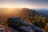 Sunrise over the Saxon Switzerland National Park, with view to the Mittelwinkel in the Schrammstein rock formation in late summer, Elbe valley and Zirkelstein in the background, Saxony, Germany