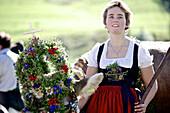 Woman wearing a dirndl with a decorated cattle, Viehscheid, Allgau, Bavaria, Germany