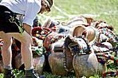 Man wearing traditional clothes near several cow bells, Viehscheid, Allgau, Bavaria, Germany