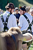 Two men wearing traditional clothes, Viehscheid, Allgau, Bavaria, Germany