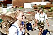 Woman and man wearing traditional clothes, Viehscheid, Allgau, Bavaria, Germany
