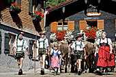 Family wearing traditional clothes, Viehscheid, Allgau, Bavaria, Germany