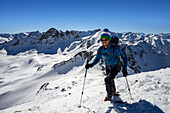 Mountaineer shortly before the summit of the Schwarzhorn (3146 m), summits in the background from left to right: Piz Radoent, Raduener Rothorn, Piz Palue, Piz Bernina, Grisons, Switzerland, Europe